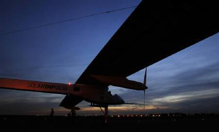 The solar-powered HB-SIA prototype flown by Solar Impulse's Chief Executive Officer and pilot Andre Borschberg, lands at Zaventem's international airport near Brussels May 13, 2011. The plane made its first international trip.  REUTERS/Thierry Roge