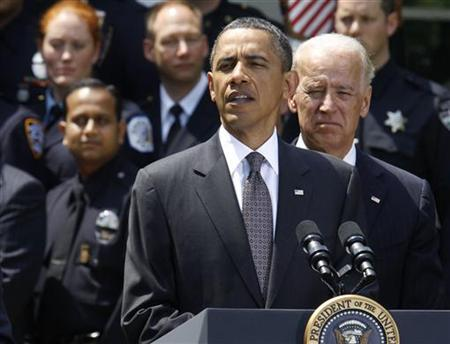 U.S. President Barack Obama (L) speaks while U.S. Vice President Joseph Biden (R) listens during a ceremony in honor of the National Association of Police Organizations' Top Cops award winners for 2011 in the Rose Garden of the White House in Washington, May 12, 2011. REUTERS/Larry Downing