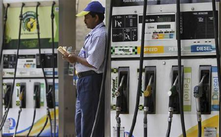 An employee counts money at a fuel station in Kolkata April 7, 2011. REUTERS/Rupak De Chowdhuri/Files