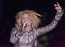 "<p>Colombian pop star Shakira performs during heavy rain for her concert, as part of ""The Sun Comes Out World Tour"", in Bucharest May 7, 2011. REUTERS/Bogdan Cristel</p>"