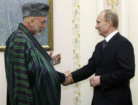Russia's Prime Minister Vladimir Putin (R) greets Afghanistan's President Hamid Karzai at the Novo-Ogaryovo residence outside Moscow January 21, 2011. Russia has welcomed Afghan  Karzai twice in the past 12 months, where he directly asked his Russian counterpart Dmitry Medvedev for help with security. REUTERS/Alexei Nikolsky/RIA Novosti/Pool/Files