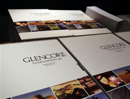 Brochures for Glencore International's IPO are seen at a news conference in Hong Kong May 12, 2011. REUTERS/Bobby Yip