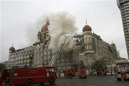 Firefighters douse a blaze at the Taj Mahal Hotel in Mumbai November 29, 2008. REUTERS/Desmond Boylan