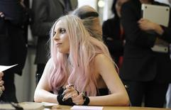 <p>Performing artist Lady Gaga guest edits at the offices of Metro International in London, May 16, 2011. REUTERS/Paul Hackett</p>