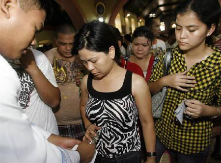 Women queue for their wombs to be blessed inside a Catholic Church where hundreds of people dance and pray for children in an annual fertility ceremony in Obando, north of Manila May 17, 2011. REUTERS/Cheryl Ravelo