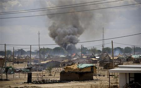 Smoke rise from burnt homes in Abyei town, in this handout photo released by the United Nations Mission in Sudan May 23, 2011. REUTERS/Stuart Price/UNMIS