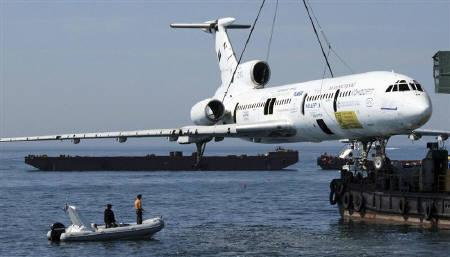 People look on from a boat as a Soviet-made Tupolev-154 plane of former Bulgarian Communist ruler Todor Zhivkov is prepared to be submerged in the Black Sea waters near the city of Varna, some 450 km (280 miles) northeast of Sofia May 25, 2011.    REUTERS/Krasimir Delchev/BGNES