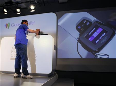 Vice President of Google Payments Osama Bedier demonstrates how to use the Google wallet application during a news conference unveiling the mobile payment system in New York May 26, 2011. REUTERS/Shannon Stapleton