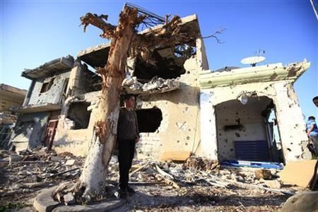 A boy stands by a house destroyed in battles between rebels fighters and forces loyal to Muammar Gaddafi on Tripoli street in central Misrata May 29,2011. REUTERS/Zohra Bensemra