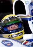 <p>Brazilian Formula One driver Ayrton Senna listens to a technician before a test drive in a Williams Renault car in Portugal REUTERS/Benoit Doppagne 20/01/1994</p>