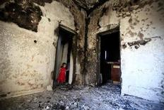 <p>A girl stands in the doorway of a home destroyed in battles between rebel fighters and forces loyal to Muammar Gaddafi on Tripoli street in central Misrata May 29, 2011. REUTERS/Zohra Bensemra</p>