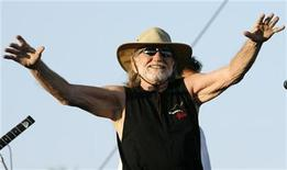 <p>Singer Willie Nelson greets fans before the start of his performance at the Coachella Music Festival in Indio, California April 29, 2007. REUTERS/Mario Anzuoni</p>