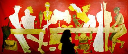 A visitor looks at a painting by India's renowned artist M.F. Husain during an exhibition in Mumbai, Jauary 14, 2004. REUTERS/Punit Paranjpe/Files