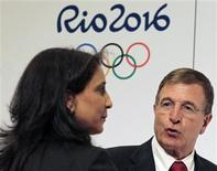 Nawal El Moutawakel e Gilbert Felli após entrevista coletiva da comissão de avaliação do COI para os Jogos Olímpicos do Rio de Janeiro. 09/06/2011 REUTERS/Sergio Moraes