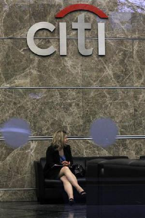 A woman waits in the lobby of Citi bank at Canary Wharf in London April 5, 2011. Major U.S. banks came under growing pressure from banking regulators to improve the security of their customer account information. after Citigroup Inc became the latest high-profile victim of a large-scale cyber attack. REUTERS/Suzanne Plunkett/Files