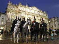 <p>Carabinieris on horses are positioned in front of the La Scala opera house in Milan December 7, 2010. REUTERS/Alessandro Garofalo</p>