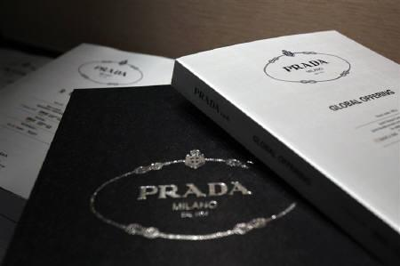 Brochures for Prada's global offering are shown during a news conference in Hong Kong June 12, 2011. Italian fashion house Prada, which is seeking to raise up to $2.6 billion through a Hong Kong IPO, has generated five times demand for its offer, a source familiar with the matter told Reuters on Sunday. REUTERS/Tyrone Siu
