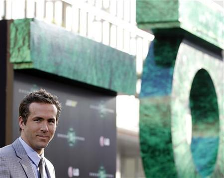 Cast member Ryan Reynolds poses at the premiere of ''Green Lantern'' at the Grauman's Chinese theatre in Hollywood, California June 15, 2011. REUTERS/Mario Anzuoni