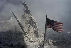 <p>An American flag flies near the base of the destroyed World Trade Center in New York, in this file photo from September 11, 2001, taken after the collapse of the towers. REUTERS/Peter Morgan-Files</p>