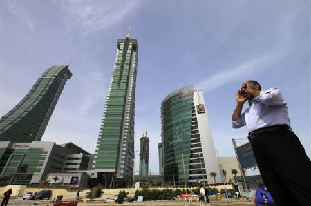 A person is seen standing at the junction of Bahrain Financial Harbour in Manama March 14, 2011.   REUTERS/Hamad I Mohammed/Files