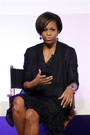 U.S. first lady Michelle Obama speaks at a Joining Forces event at the Writers Guild theatre in Beverly Hills, California June 13, 2011. REUTERS/Mario Anzuoni