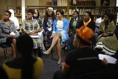 <p>U.S. first lady Michelle Obama participates during breakout sessions at the Young African Youth Leaders Forum in Johannesburg, June 22, 2011. REUTERS/Charles Dharapak/Pool</p>