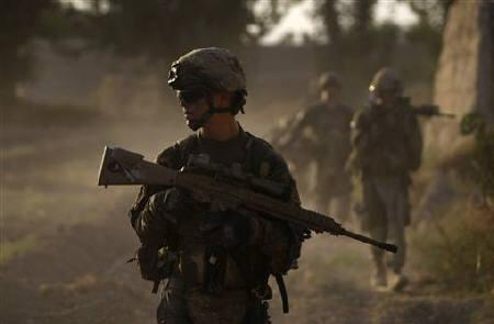 US army soldiers from Charlie company 4th platoon,1st brigade 3-21 infantry, patrol in the village of Chariagen in the Panjwai district of Kandahar province southern Afghanistan June 22 , 2011. REUTERS/Baz Ratner