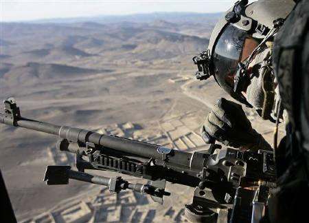 A U.S soldier from Task Force Viper looks out as a Chinook CH-47F transport helicopter flies back to FOB Salerno, Afghanistan, December 2, 2009. REUTERS/Zohra Bensemra/Files