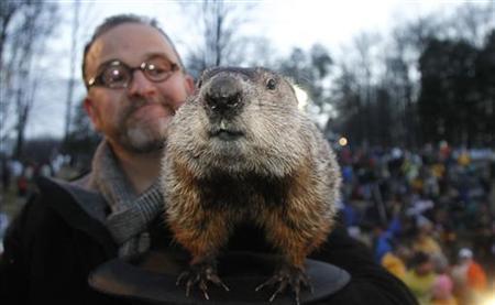 Official Groundhog Handler Ben Hughes holds Punxsutawney Phil after Phil made his annual Groundhog Day prediction on Gobbler's Knob in Punxsutawney, Pennsylvania, February 2, 2011. REUTERS/ Jason Cohn