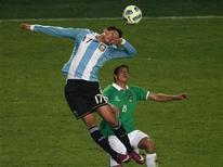 A seleção da Bolívia surpreendeu a Argentina, jogando em casa e favorita no Grupo A da Copa América, no empate de 1 a 1 na partida de abertura do torneio nesta sexta-feira no estádio Cidade de La Plata. REUTERS/Paulo Whitaker