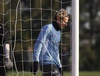 O atacante uruguaio Diego Forlán, eleito melhor jogador da última Copa do Mundo, elogiou no sábado o poder ofensivo de sua equipe, dizendo estar em boa forma antes da estréia na Copa América, em que joga contra a Peru pelo Grupo C. REUTERS/Pablo La Rosa