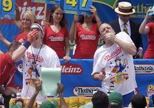 <p>Pat Bertoletti (L) and Joey Chestnut compete in the 2011 Nathan's Famous Fourth of July International Hot Dog Eating Contest at Coney Island, Brooklyn, New York July 4, 2011. REUTERS/Allison Joyce</p>