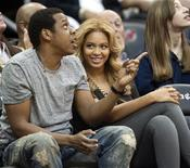 <p>Jay Z and his wife Beyonce watching the New Jersey Nets play the Phoenix Suns in Newark, February 28, 2011. REUTERS/Ray Stubblebine</p>