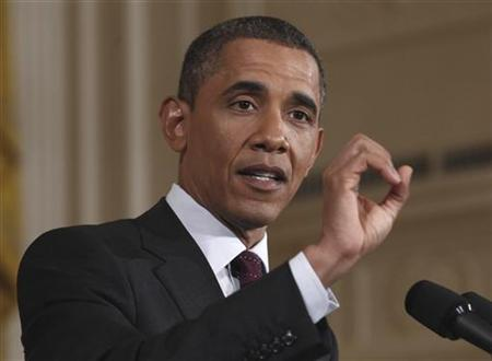 U.S. President Barack Obama gestures as he answers a question during a news conference in the East Room of the White House in Washington, June 29, 2011. REUTERS/Kevin Lamarque