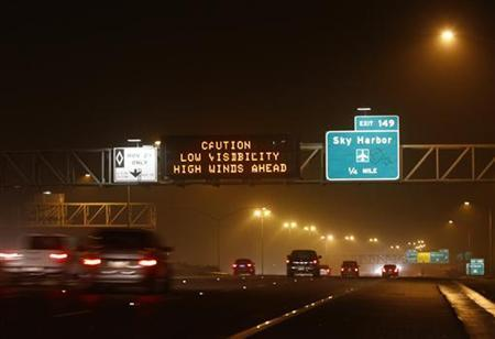 Motorists drive along Interstate-10 during a dust storm in Phoenix, Arizona July 5, 2011. Visibility was reduced to zero in some areas as wind gust blew near 40 miles per hour, local media reported on Tuesday. REUTERS/Joshua Lott