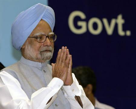 Prime Minister Manmohan Singh gestures during the national communal harmony awards ceremony in New Delhi August 12, 2009.REUTERS/B Mathur/Files