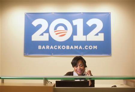 A volunteer receptionist answers the phone at President Obama's campaign headquarters in Chicago, May 12, 2011. REUTERS/John Gress