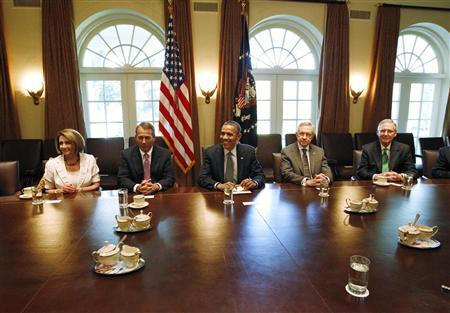 President Obama conducts a meeting with congressional leadership on deficit reduction in the Cabinet Room of the White House, July 14, 2011. Pictured with Obama are (L-R) House Minority Leader Nancy Pelosi (D-CA), House Speaker John Boehner (R-OH), Senate Majority Leader Harry Reid (D-NV) and Senate Minority Leader Mitch McConnell (R-KY). REUTERS/Jason Reed