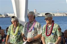 <p>Pearl Harbor survivors Alfred Rodrigues (L), Ray Emory and Sterling Cale (R) are seen at the start of the Japanese Tea Ceremony onboard the USS Arizona Memorial in Honolulu July 19, 2011. REUTERS/Marco Garcia</p>