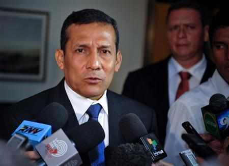 Peru's President-elect Ollanta Humala speaks to reporters at Havana's Jose Marti Airport before departing after a one-day working visit to Cuba July 19, 2011. REUTERS/Adalberto Roque/Pool