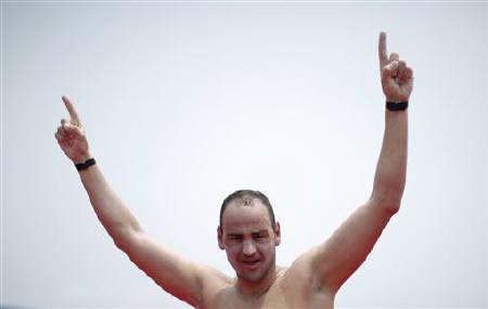 Bulgaria's Petar Stoychev gestures after winning the men's 25km open water race at the 14th FINA World Championships in Shanghai July 23, 2011. REUTERS/Carlos Barria