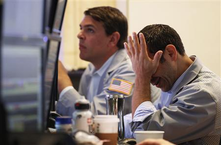 Traders work on the floor of the New York Stock Exchange in New York July 25, 2011. REUTERS/Lucas Jackson