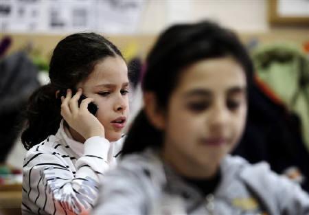 Marko Calasan attends class at his elementary school in Skopje February 8, 2010. REUTERS/Ognen Teofilovski/Files