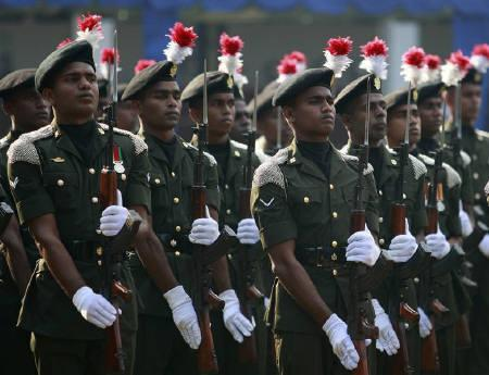 Soldiers stand at attention at a ceremony marking the 55th anniversary of the Sri Lanka Army Armored Corps (SLAC)  in Colombo December 15, 2010. Sri Lanka's military in May last year ended the 25-year war against separatist Liberation Tigers of Tamil Eelam (LTTE), which killed over 100,000 people. REUTERS/Dinuka Liyanawatte/Files