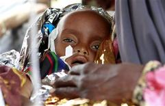 <p>Rukiya Mohamed, a severely malnourished one-year-old girl refugee from Madaitu Village in Somalia, is wrapped in foil at the Medecins Sans Frontieres (MSF) (Doctors Without Borders) clinic at the United Nations High Commissioner for Refugees (UNHCR) transit centre in Dolo Ado near the Ethiopia-Somalia border August 11, 2011. REUTERS/Thomas Mukoya</p>
