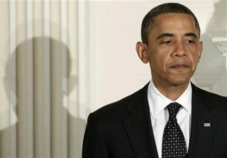 U.S. President Barack Obama pauses as he speaks at an iftar dinner celebrating Ramadan at the White House in Washington August 10, 2011. REUTERS/Yuri Gripas