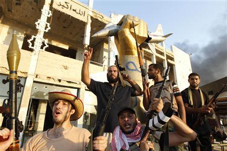 Libyan rebels celebrate at Bab Al-Aziziya compound in Tripoli,August 23, 2011. REUTERS/Louafi Larbi