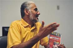 <p>Libya's most popular comedian Milood Amroni gestures during an interview in Benghazi August 20, 2011. REUTERS/Esam Al-Fetori</p>