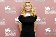 """Madonna, diretora do filme """"W.E"""", no Festival de Cinema de Veneza, na Itália. Madonna agradeceu a seus ex-maridos por incentivá-la a buscar uma carreira no cinema ao chegar em Veneza, nesta quinta-feira, para a estreia mundial de seu luxuoso drama real """"W.E."""".01/09/2011 REUTERS/Alessandro Garofalo"""