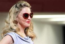 """<p>Pop star and director Madonna poses for photographers on the """"W.E"""" red carpet at the 68th Venice Film Festival September 1, 2011. REUTERS/Alessandro Garofalo</p>"""